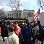 Forward on Climate marchers pass the White House.