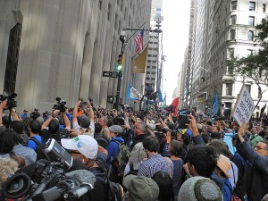 Police meet protesters at the intersection of Broadway and Wall Street