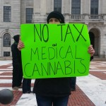 Medical marijuana tax opponents rally at State House