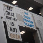 Banners dropped at RI Office of Energy Resources opposing power plant