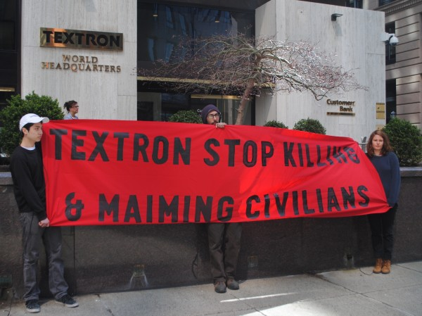 Peace activists demonstrated in front of Textron's world headquarters in April for its role in supplying cluster bombs to Saudi Arabia. (Photo: RiFuture.org/@SteveAhlquist)