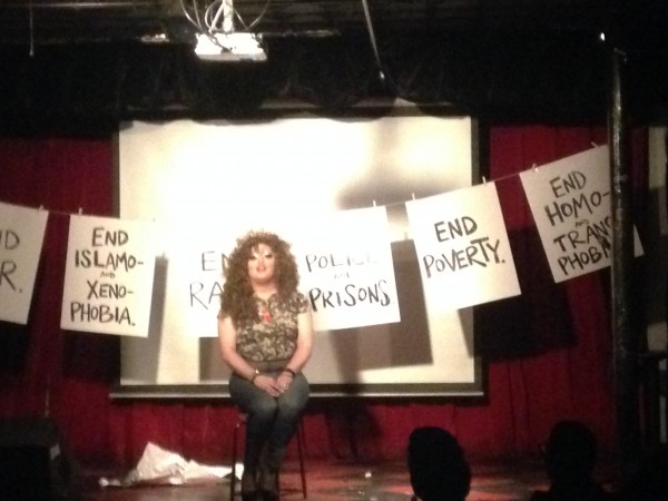 This performance had o[pened with these slogans being covered with images of Trump, Clinton, and other political figures.