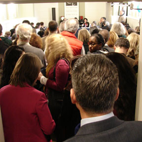 The overflow crowd spilled out the door.