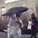 Hotel workers, supporters protest firings in the pouring rain