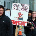 'Wage Theft Street Theater' outside Gourmet Heaven