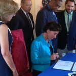 Gov. Gina Raimondo signing the Community-Police Relationship Act