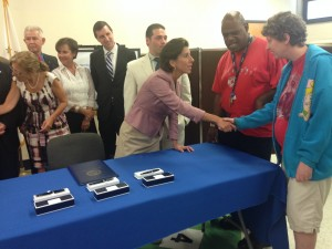 Gov. Raimondo shaking hands with Cornerstone students