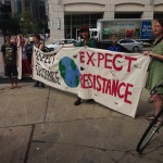 Protestors rally in front of Providence Chamber of Commerce as Gov. Raimondo announces Clear River Energy Center