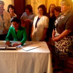 Gov. Raimondo signing bill to give Sec. of State Gorbea authorization to buy new voting equipment.
