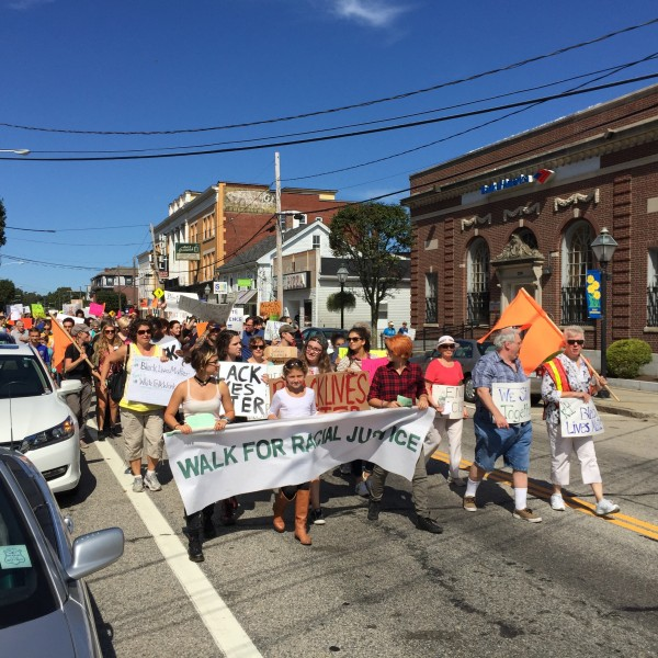 The March for Racial Justice head down Main Street in East Greenwich, on Sunday, Sept. 20.