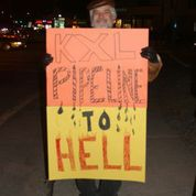 Robert Malin provides a sense of direction at KXL Vigil in Wakefield, RI