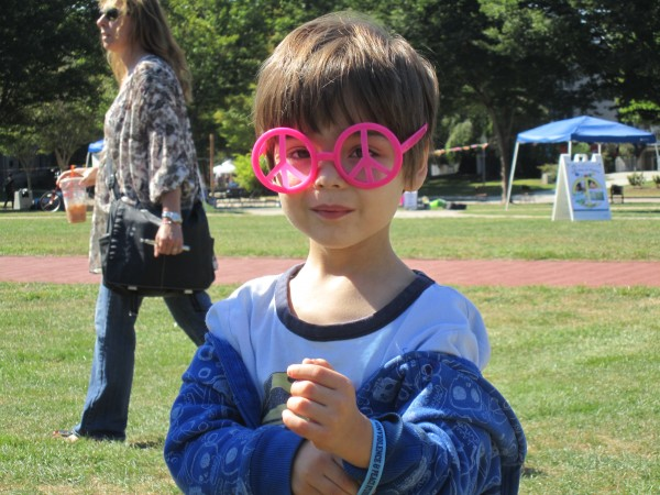 My oldest grandson, and youngest Fossil Free RI member, Octavio, at Peace Day on  Quad at URI
