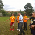 Mayor Jorge Elorza playing catch with After Zone students.