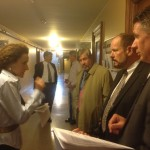 Reps Lisa Baldelli-Hunt and Jon Brien talk to Woonsocket&#039;s finance director Tuesday after a vote on a supplemtnal tax increase for the struggling city.