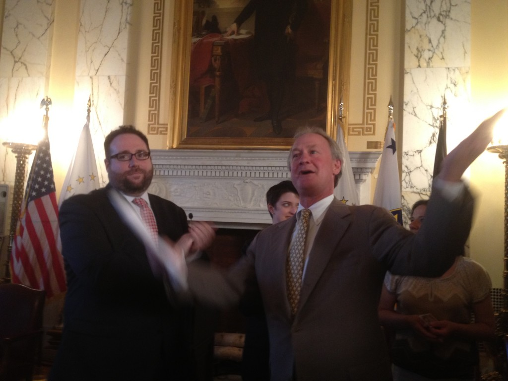 Ray Sullivan, of Marriage Equality Rhode Island, and Gov. Chafee celebrate his executive order recognizing same sex marriages from other states. (Photo by Bob Plain)