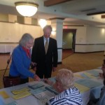 Virginia Chafee shows her id to a poll worker.