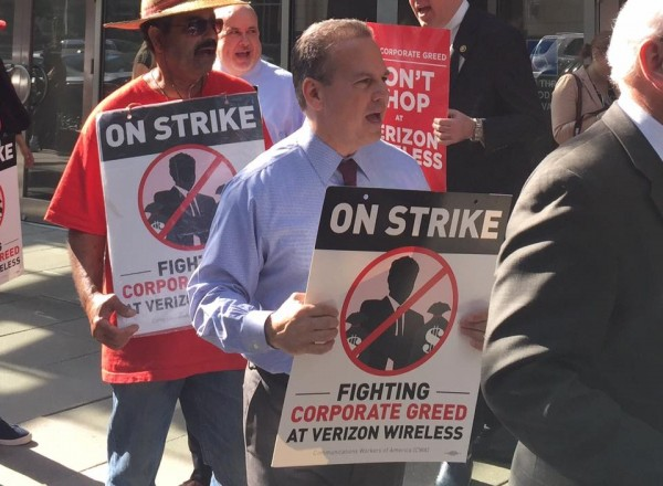 Congressman David Cicilline marching with Verizon workers earlier this week.