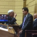George Nee, president of the AFL-CIO, talks to House Speaker Gordon Fox. (Photo by Bob Plain)