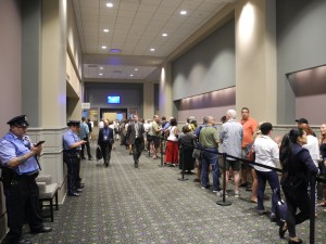 Interested audience members line up outside the Rules Committee meeting.