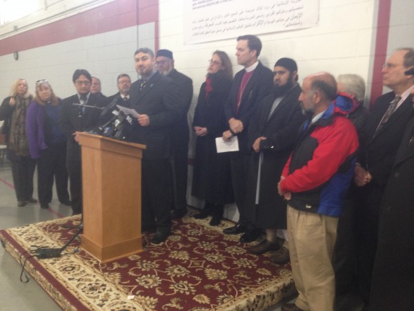 Hilmy Bakri, president of the board of trustees for the Islamic School of Rhode Island, addresses the media.