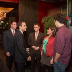 Providence Mayor Angel Taveras confers with Kristina Fox, who is flanked by Young Dems Alex Morash and Aaron Regunberg.