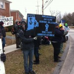 An Occupy Providence protester at an action against Pfizer in Groton Conn. (photo courtesy Occupy Providence)