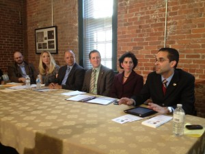Providence Mayor Angel Taveras and Treasurer Gina Raimondo at a recent panel on payday loan reform, an issue they both supported.