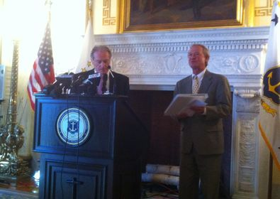 John Simmons, executive director of RIPEC, and Gov. Linc Chafee. (Photo by Steve Klamkin / 630wpro.com)
