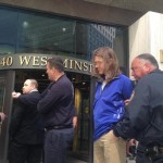 Anti-cluster bomb activists arrested for chaining themselves to Textron building