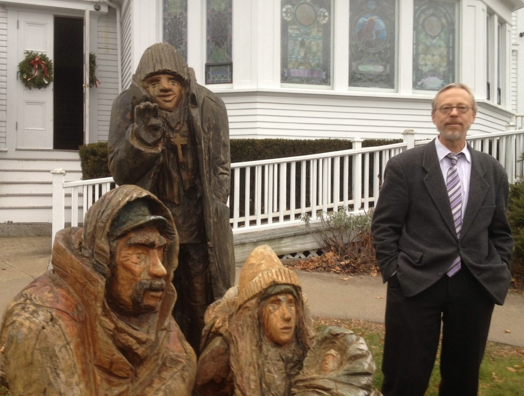 Bill Sterritt, the minister at Amicable Congregational Church, poses with the statues that star in his telling of the Christmas story.